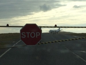 One of the sights of Shetland - in the taxi, stopped at the runway's level crossing to wait for a plane to take off!